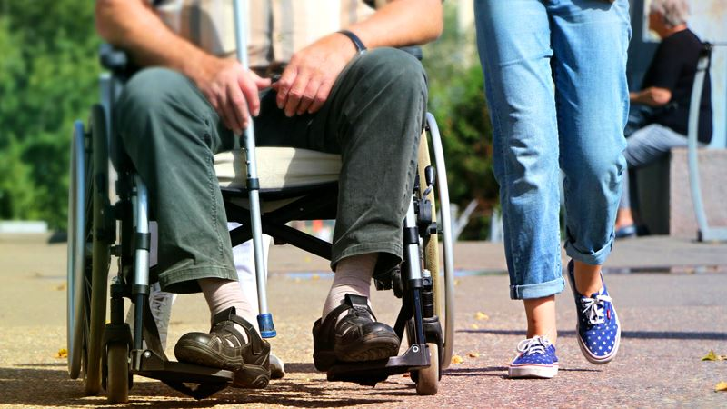 Wheelchair on Sidewalk ADA Americans with Disabilities Act Accessibility