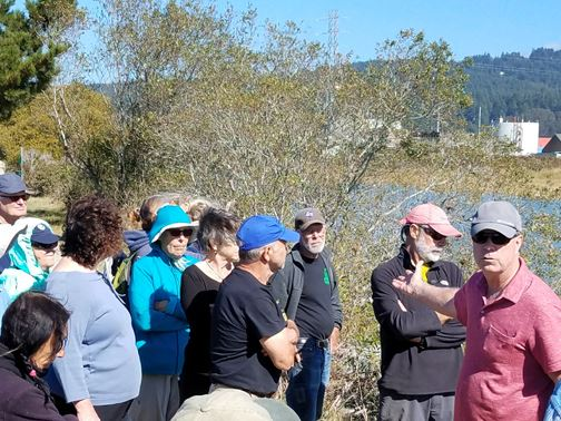 Mark Andre and Doby Class Discussing Sea Level Rise on Trail Walk