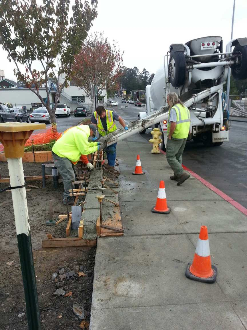 City Workers Pouring Concrete for New Foundation 2
