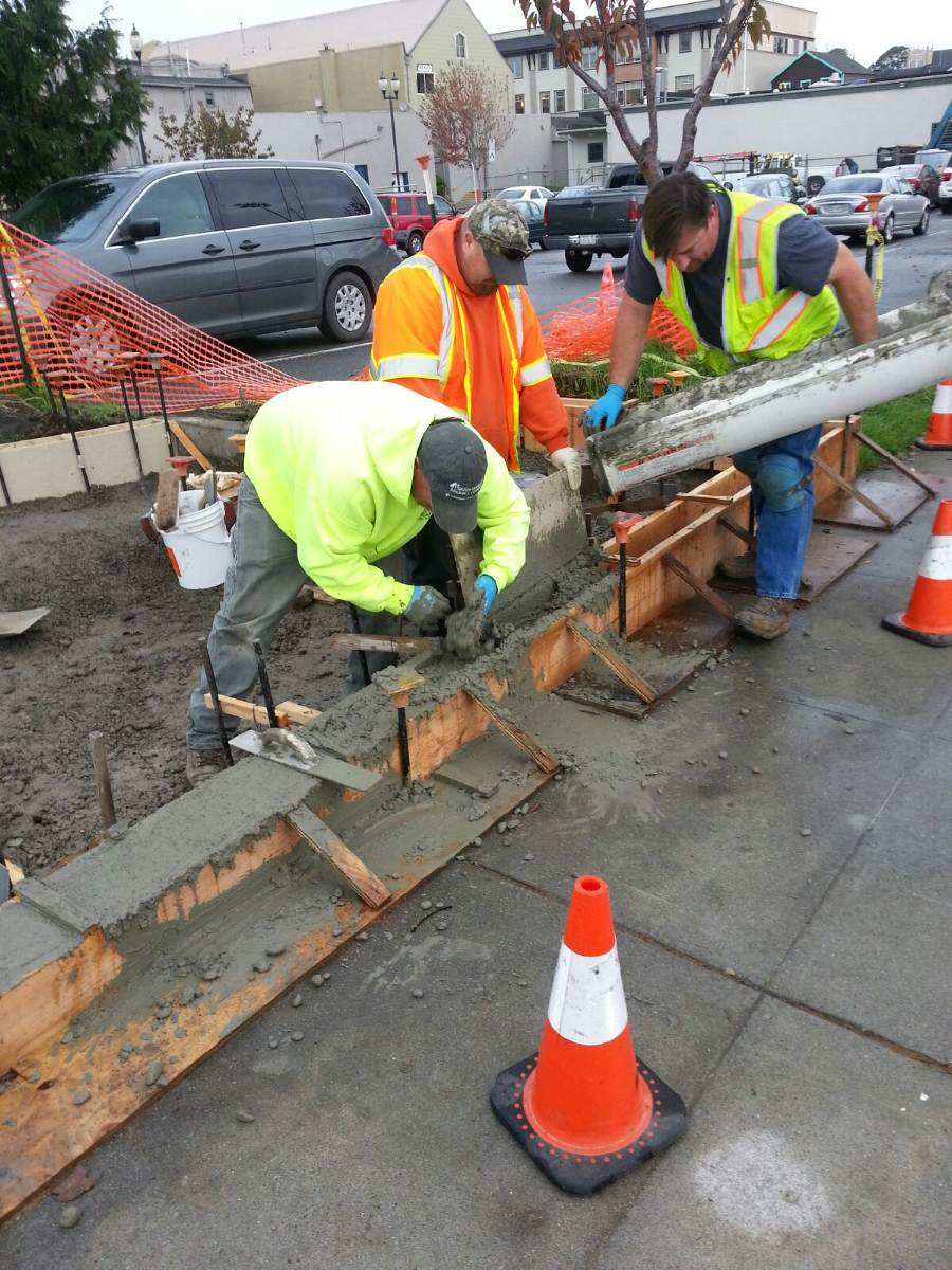City Workers Pouring Concrete for New Foundation