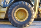A large tire on a piece of heavy equipment