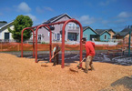 2 men spreading ground-cover on a playground