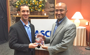 TSC Vice Chair Josh Wolff and Assistant City Engineer Netra Khatri Accept ASCE Project of the Year Award